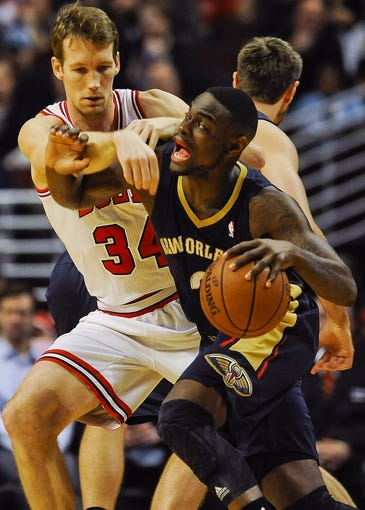 Dec 2, 2013; Chicago, IL, USA; Chicago Bulls small forward Mike Dunleavy (34) guards New Orleans Pelicans shooting guard Anthony Morrow (3) during the first half of their game at the United Center.  Mandatory Credit: Matt Marton-USA TODAY Sports