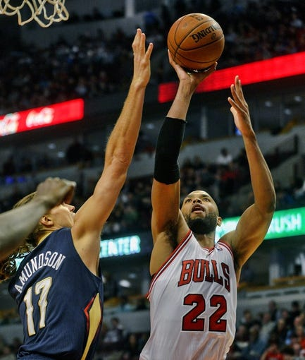 Dec 2, 2013; Chicago, IL, USA; Chicago Bulls power forward Taj Gibson (22) shoots against New Orleans Pelicans power forward Lou Amundson (17) during the first half of their game at the United Center.  Mandatory Credit: Matt Marton-USA TODAY Sports