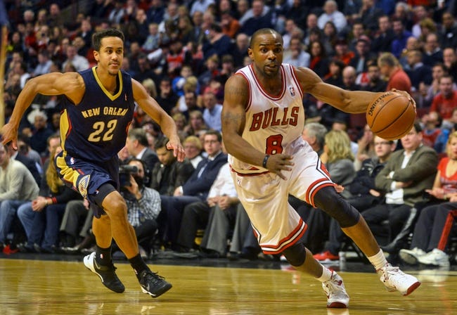 Dec 2, 2013; Chicago, IL, USA; Chicago Bulls point guard Mike James (8) dribbles against Chicago Bulls power forward Taj Gibson (22) during the first half of their game at the United Center.  Mandatory Credit: Matt Marton-USA TODAY Sports
