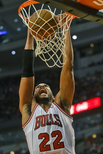Dec 2, 2013; Chicago, IL, USA; Chicago Bulls power forward Taj Gibson (22) scores against New Orleans during the first half of their game at the United Center.  Mandatory Credit: Matt Marton-USA TODAY Sports