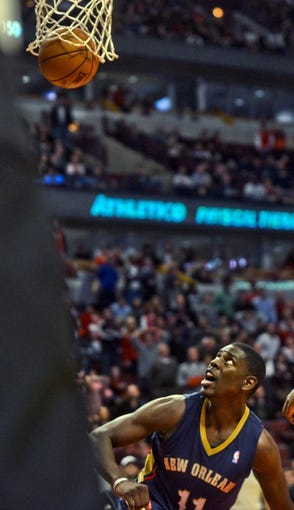 Dec 2, 2013; Chicago, IL, USA; New Orleans Pelicans point guard Jrue Holiday (11) watches his game winning basket fall during the third overtime of their game against the Chicago Bulls at the United Center.  Mandatory Credit: Matt Marton-USA TODAY Sports