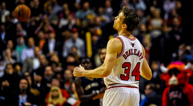 Dec 2, 2013; Chicago, IL, USA; Chicago Bulls small forward Mike Dunleavy (34) reacts to his missed three point attempt at the end of the third overtime of their game against the New Orleans Pelicans at the United Center. The Pelicans won 131-126.  Mandatory Credit: Matt Marton-USA TODAY Sports