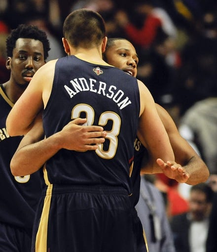 Dec 2, 2013; Chicago, IL, USA; New Orleans Pelicans power forward Anthony Davis (23), and shooting guard Eric Gordon (10) react at the end of the third overtime of their game against the Chicago Bulls at the United Center. The Pelicans won 131-126.  Mandatory Credit: Matt Marton-USA TODAY Sports