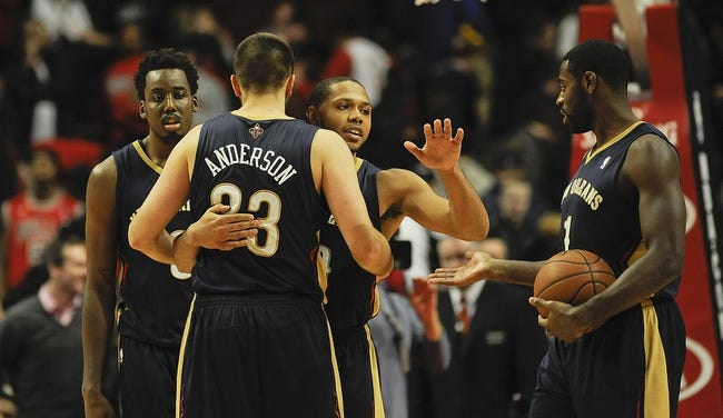 Dec 2, 2013; Chicago, IL, USA; New Orleans Pelicans power forward Anthony Davis (23), shooting guard Eric Gordon (10) point guard Tyreke Evans (1) and small forward Al-Farouq Aminu (0)  react at the end of the third overtime of their game against the Chicago Bulls at the United Center. The Pelicans won 131-126.  Mandatory Credit: Matt Marton-USA TODAY Sports