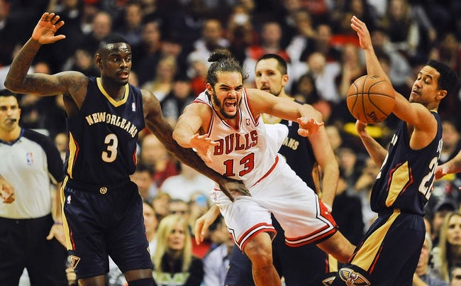 Dec 2, 2013; Chicago, IL, USA; Chicago Bulls center Joakim Noah (13) passes away from New Orleans Pelicans shooting guard Anthony Morrow (3) and point guard Brian Roberts (22) at the United Center. The Pelicans beat the Bulls 131-128.  Mandatory Credit: Matt Marton-USA TODAY Sports