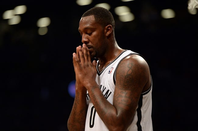 Nov 27, 2013; Brooklyn, NY, USA; Brooklyn Nets center Andray Blatche (0) reacts to a foul call against the Los Angeles Lakers at Barclays Center. The Lakers won 99-94. Mandatory Credit: Joe Camporeale-USA TODAY Sports