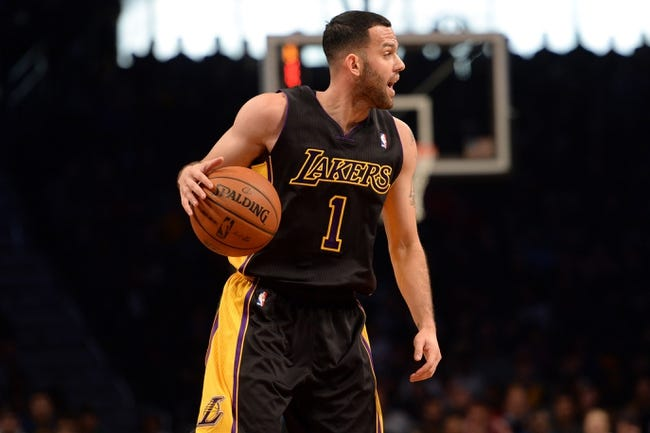Nov 27, 2013; Brooklyn, NY, USA; Los Angeles Lakers point guard Jordan Farmar (1) dribbles against the Brooklyn Nets at Barclays Center. The Lakers won 99-94. Mandatory Credit: Joe Camporeale-USA TODAY Sports