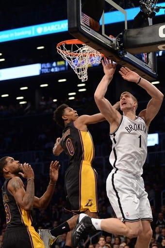Nov 27, 2013; Brooklyn, NY, USA; Brooklyn Nets power forward Mason Plumlee (1) puts up a layup against the Los Angeles Lakers at Barclays Center. The Lakers won 99-94. Mandatory Credit: Joe Camporeale-USA TODAY Sports