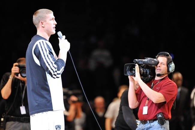 Nov 27, 2013; Brooklyn, NY, USA; Brooklyn Nets power forward Mason Plumlee (1) addresses fans before facing the Los Angeles Lakers at Barclays Center. The Lakers won 99-94. Mandatory Credit: Joe Camporeale-USA TODAY Sports