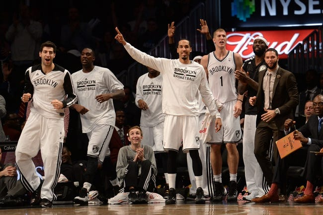 Nov 27, 2013; Brooklyn, NY, USA; Brooklyn Nets players cheer against the Los Angeles Lakers at Barclays Center. The Lakers won 99-94. Mandatory Credit: Joe Camporeale-USA TODAY Sports