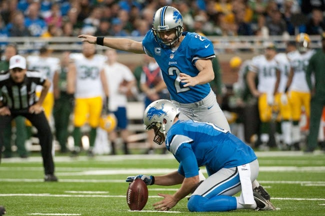 Nov 28, 2013; Detroit, MI, USA; Detroit Lions punter Sam Martin (6) holds the ball as kicker David Akers (2) kicks a field goal against the Green Bay Packers during a NFL football game on Thanksgiving at Ford Field. Mandatory Credit: Tim Fuller-USA TODAY Sports