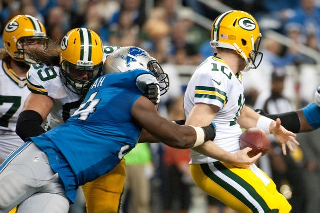 Nov 28, 2013; Detroit, MI, USA; Detroit Lions defensive end Ezekiel Ansah (94) sacks Green Bay Packers quarterback Matt Flynn (10) during a NFL football game on Thanksgiving at Ford Field. Mandatory Credit: Tim Fuller-USA TODAY Sports