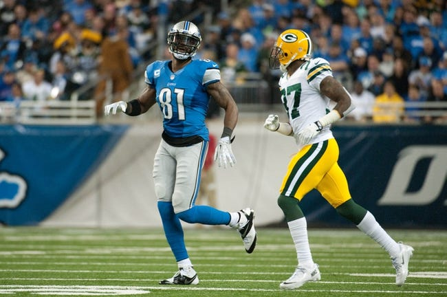 Nov 28, 2013; Detroit, MI, USA; Detroit Lions wide receiver Calvin Johnson (81) and Green Bay Packers cornerback Sam Shields (37) during a NFL football game on Thanksgiving at Ford Field. Mandatory Credit: Tim Fuller-USA TODAY Sports