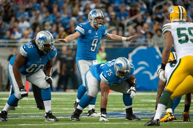 Nov 28, 2013; Detroit, MI, USA; Detroit Lions quarterback Matthew Stafford (9) during the game against the Green Bay Packers during a NFL football game on Thanksgiving at Ford Field. Mandatory Credit: Tim Fuller-USA TODAY Sports