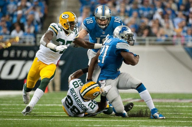 Nov 28, 2013; Detroit, MI, USA; Green Bay Packers safety Sean Richardson (28) tackles Detroit Lions running back Reggie Bush (21) during the fourth quarter during a NFL football game on Thanksgiving at Ford Field. Detroit won 40-10. Mandatory Credit: Tim Fuller-USA TODAY Sports
