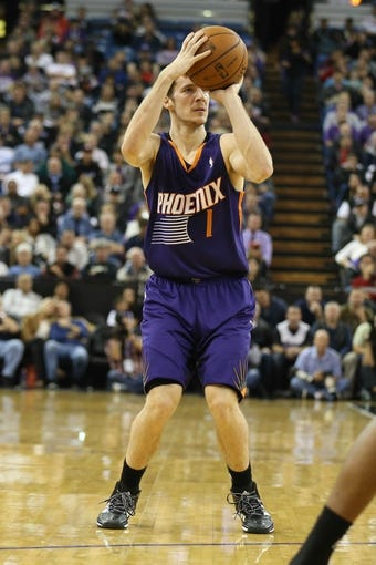 Nov 19, 2013; Sacramento, CA, USA; Phoenix Suns shooting guard Goran Dragic (1) shoots the ball against the Sacramento Kings during the second quarter at Sleep Train Arena. Mandatory Credit: Kelley L Cox-USA TODAY Sports