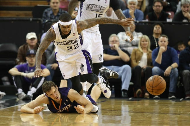 Nov 19, 2013; Sacramento, CA, USA; Phoenix Suns shooting guard Goran Dragic (1) is called for a loose ball foul against Sacramento Kings point guard Isaiah Thomas (22) during the fourth quarter at Sleep Train Arena. The Sacramento Kings defeated the Phoenix Suns 107-104. Mandatory Credit: Kelley L Cox-USA TODAY Sports