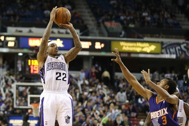 Nov 19, 2013; Sacramento, CA, USA; Sacramento Kings point guard Isaiah Thomas (22) shoots the ball against the Phoenix Suns during the fourth quarter at Sleep Train Arena. The Sacramento Kings defeated the Phoenix Suns 107-104. Mandatory Credit: Kelley L Cox-USA TODAY Sports