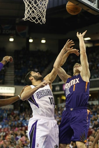 Nov 19, 2013; Sacramento, CA, USA; Phoenix Suns shooting guard Goran Dragic (1) shoots the ball against Sacramento Kings point guard Greivis Vasquez (10) during the first quarter at Sleep Train Arena. Mandatory Credit: Kelley L Cox-USA TODAY Sports