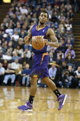 Nov 19, 2013; Sacramento, CA, USA; Phoenix Suns point guard Ish Smith (3) controls the ball against the Sacramento Kings during the first quarter at Sleep Train Arena. Mandatory Credit: Kelley L Cox-USA TODAY Sports