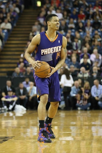 Nov 19, 2013; Sacramento, CA, USA; Phoenix Suns shooting guard Gerald Green (14) controls the ball against the Sacramento Kings during the first quarter at Sleep Train Arena. Mandatory Credit: Kelley L Cox-USA TODAY Sports