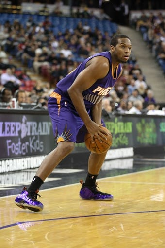 Nov 19, 2013; Sacramento, CA, USA; Phoenix Suns shooting guard Dionte Christmas (25) controls the ball against the Sacramento Kings during the first quarter at Sleep Train Arena. Mandatory Credit: Kelley L Cox-USA TODAY Sports