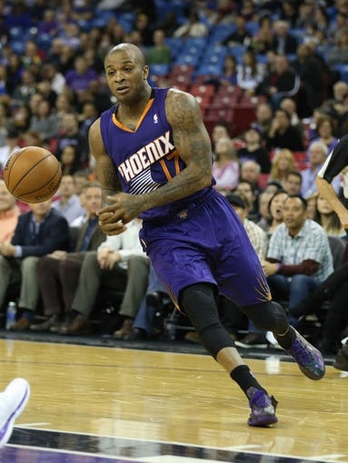 Nov 19, 2013; Sacramento, CA, USA; Phoenix Suns small forward P.J. Tucker (17) drives in against the Sacramento Kings during the first quarter at Sleep Train Arena. Mandatory Credit: Kelley L Cox-USA TODAY Sports