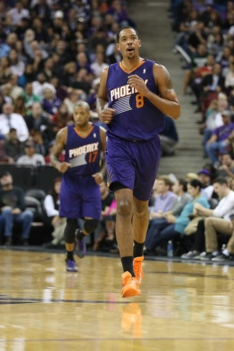 Nov 19, 2013; Sacramento, CA, USA; Phoenix Suns power forward Channing Frye (8) reacts after a basket against the Sacramento Kings during the third quarter at Sleep Train Arena. The Sacramento Kings defeated the Phoenix Suns 107-104. Mandatory Credit: Kelley L Cox-USA TODAY Sports