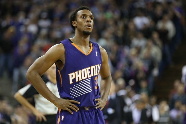 Nov 19, 2013; Sacramento, CA, USA; Phoenix Suns point guard Ish Smith (3) as the Sacramento Kings shoot free throws during the fourth quarter at Sleep Train Arena. The Sacramento Kings defeated the Phoenix Suns 107-104. Mandatory Credit: Kelley L Cox-USA TODAY Sports