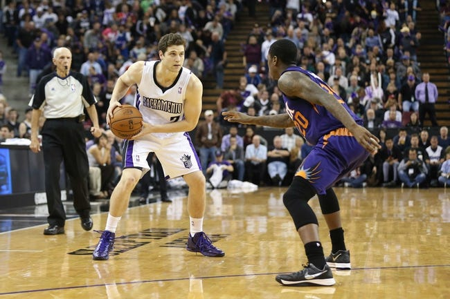 Nov 19, 2013; Sacramento, CA, USA; Sacramento Kings point guard Jimmer Fredette (7) controls the ball against Phoenix Suns shooting guard Archie Goodwin (20) during the fourth quarter at Sleep Train Arena. The Sacramento Kings defeated the Phoenix Suns 107-104. Mandatory Credit: Kelley L Cox-USA TODAY Sports