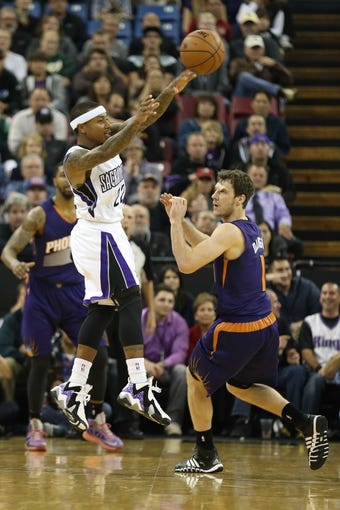 Nov 19, 2013; Sacramento, CA, USA; Sacramento Kings point guard Isaiah Thomas (22) passes the ball above Phoenix Suns shooting guard Goran Dragic (1) during the second quarter at Sleep Train Arena. Mandatory Credit: Kelley L Cox-USA TODAY Sports