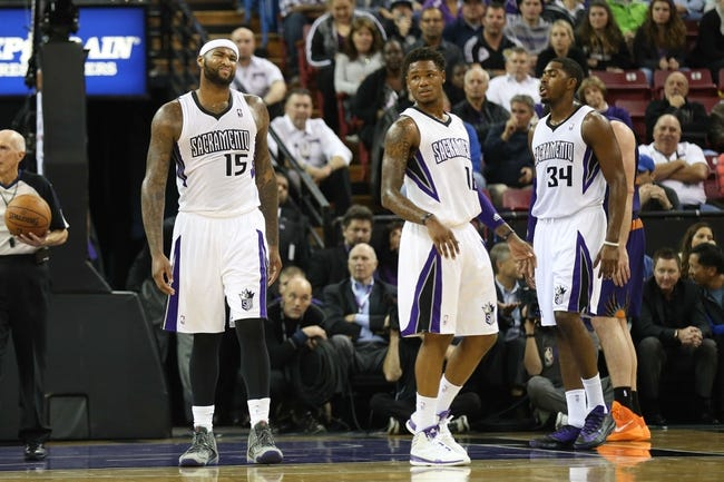 Nov 19, 2013; Sacramento, CA, USA; Sacramento Kings center DeMarcus Cousins (15) between plays against the Phoenix Suns during the second quarter at Sleep Train Arena. Mandatory Credit: Kelley L Cox-USA TODAY Sports