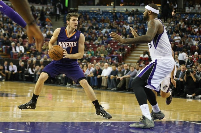 Nov 19, 2013; Sacramento, CA, USA; Phoenix Suns shooting guard Goran Dragic (1) controls the ball against Sacramento Kings center DeMarcus Cousins (15) during the first quarter at Sleep Train Arena. Mandatory Credit: Kelley L Cox-USA TODAY Sports