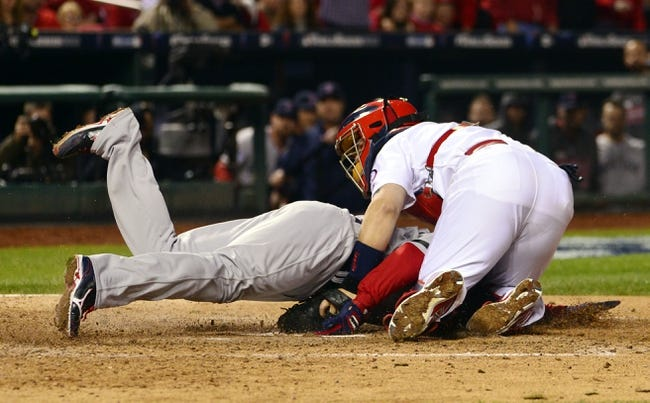 Oct 28, 2013; St. Louis, MO, USA; Boston Red Sox catcher David Ross (left) is tagged out at home plate by St. Louis Cardinals catcher Yadier Molina in the 7th inning during game five of the MLB baseball World Series at Busch Stadium. Mandatory Credit: Scott Rovak-USA TODAY Sports