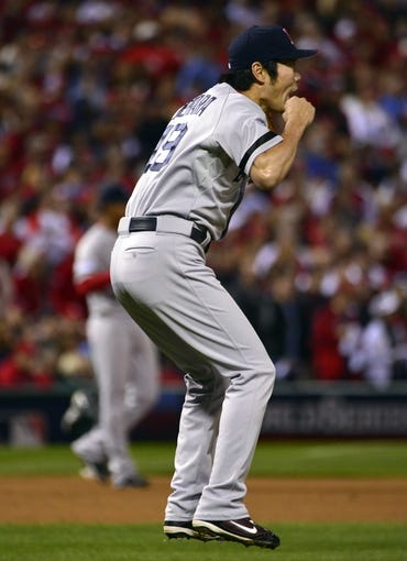 Oct 28, 2013; St. Louis, MO, USA; Boston Red Sox relief pitcher Koji Uehara (19) celebrates after game five of the MLB baseball World Series against the St. Louis Cardinals at Busch Stadium. Mandatory Credit: Scott Rovak-USA TODAY Sports