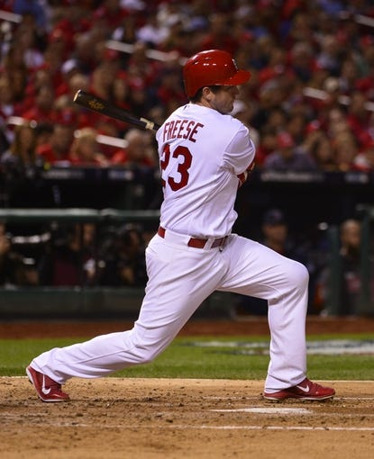 Oct 28, 2013; St. Louis, MO, USA; St. Louis Cardinals third baseman David Freese (23) hits a single against the Boston Red Sox in the 3rd inning during game five of the MLB baseball World Series at Busch Stadium. Mandatory Credit: Scott Rovak-USA TODAY Sports