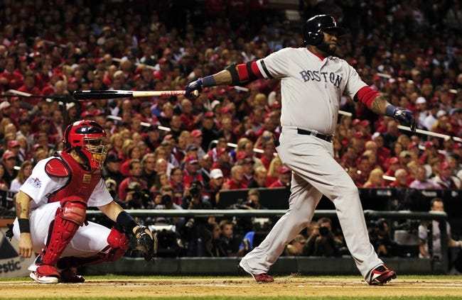 Oct 28, 2013; St. Louis, MO, USA; Boston Red Sox first baseman David Ortiz hits a double against the St. Louis Cardinals in the first inning during game five of the MLB baseball World Series at Busch Stadium. Mandatory Credit: Scott Rovak-USA TODAY Sports