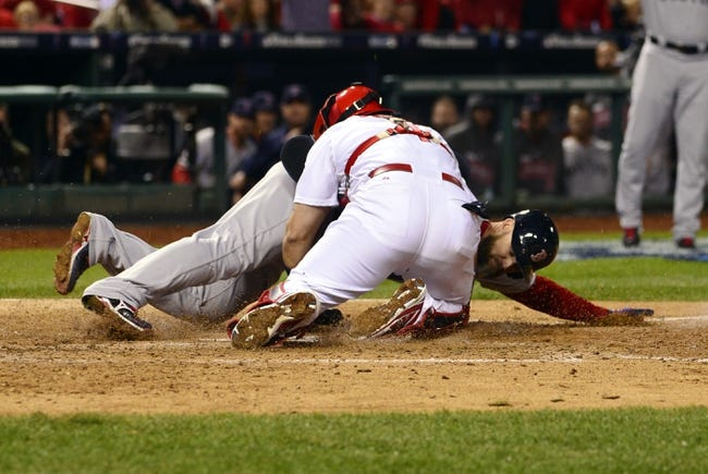 Oct 28, 2013; St. Louis, MO, USA; Boston Red Sox catcher David Ross (rear) is tagged out at home plate by St. Louis Cardinals catcher Yadier Molina in the 7th inning during game five of the MLB baseball World Series at Busch Stadium. Mandatory Credit: Scott Rovak-USA TODAY Sports