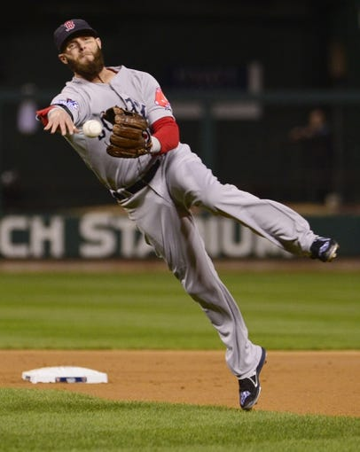 Oct 28, 2013; St. Louis, MO, USA; Boston Red Sox second baseman Dustin Pedroia (15) throws to first base against the St. Louis Cardinals in the first inning during game five of the MLB baseball World Series at Busch Stadium. Mandatory Credit: Scott Rovak-USA TODAY Sports