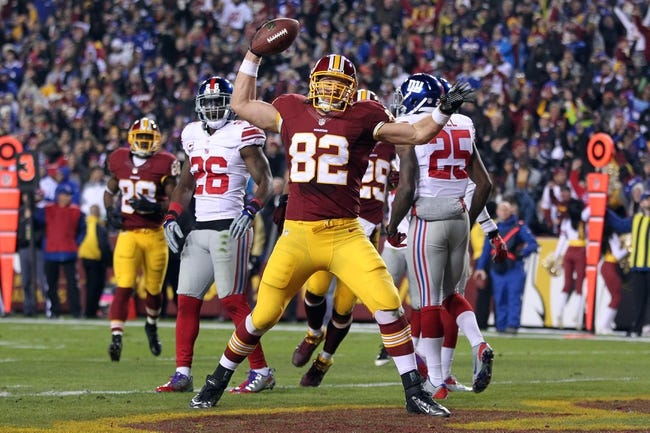 Dec 1, 2013; Landover, MD, USA; Washington Redskins tight end Logan Paulsen (82) celebrates after scoring a touchdown against the New York Giants in the second quarter at FedEx Field. The Giants won 24-17. Mandatory Credit: Geoff Burke-USA TODAY Sports