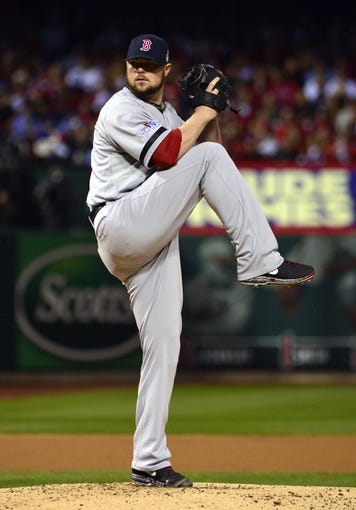 Oct 28, 2013; St. Louis, MO, USA; Boston Red Sox starting pitcher Jon Lester throws  a pitch against the St. Louis Cardinals in the first inning during game five of the MLB baseball World Series at Busch Stadium. Mandatory Credit: Scott Rovak-USA TODAY Sports