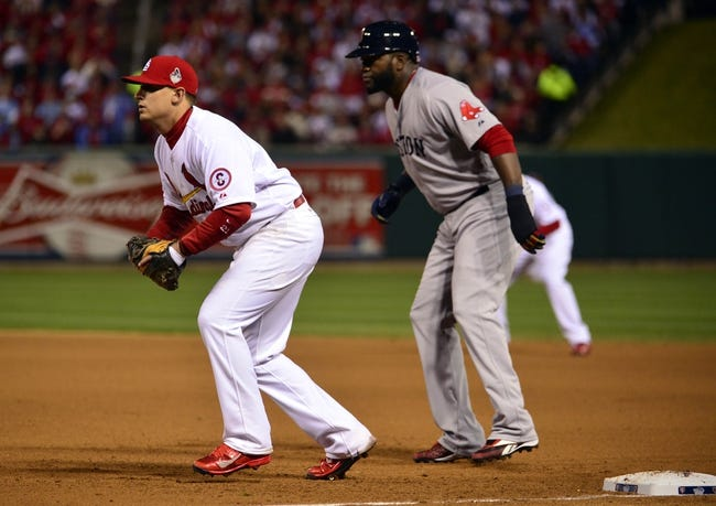 Oct 28, 2013; St. Louis, MO, USA; Boston Red Sox first baseman David Ortiz (right) leads off first base behind St. Louis Cardinals first baseman Allen Craig during game five of the MLB baseball World Series at Busch Stadium. Mandatory Credit: Scott Rovak-USA TODAY Sports