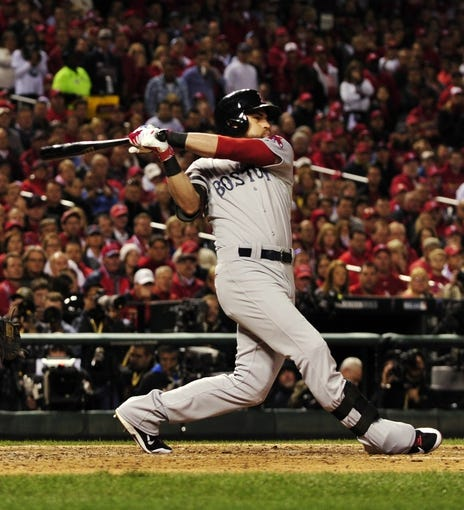 Oct 28, 2013; St. Louis, MO, USA; Boston Red Sox center fielder Jacoby Ellsbury hits a RBI single against the St. Louis Cardinals in the 7th inning during game five of the MLB baseball World Series at Busch Stadium. Mandatory Credit: Scott Rovak-USA TODAY Sports