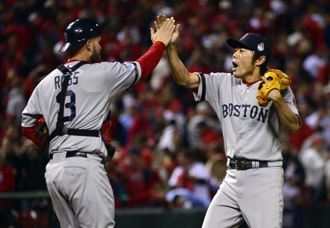 Oct 28, 2013; St. Louis, MO, USA; Boston Red Sox relief pitcher Koji Uehara (right) celebrates with catcher David Ross (3) after game five of the MLB baseball World Series against the St. Louis Cardinals at Busch Stadium. Mandatory Credit: Scott Rovak-USA TODAY Sports