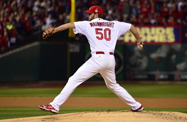 Oct 28, 2013; St. Louis, MO, USA; St. Louis Cardinals starting pitcher Adam Wainwright throws a pitch against the Boston Red Sox in the first inning during game five of the MLB baseball World Series at Busch Stadium. Mandatory Credit: Scott Rovak-USA TODAY Sports