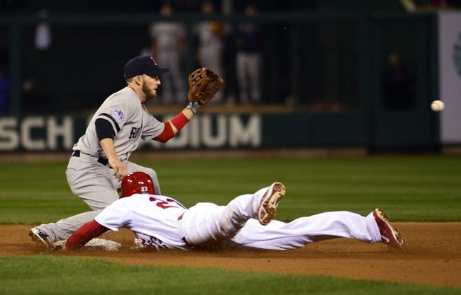 Oct 28, 2013; St. Louis, MO, USA; St. Louis Cardinals third baseman David Freese (23) slides into second base with a double ahead of the tag by Boston Red Sox shortstop Stephen Drew in the 8th inning during game five of the MLB baseball World Series at Busch Stadium. Mandatory Credit: Scott Rovak-USA TODAY Sports