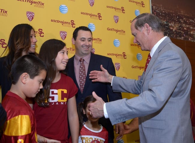 Dec 3, 2013; Los Angeles, CA, USA; Southern California Trojans athletic director Pat Haden (right) greets Steve Sarkisian (second from left) and his wife Stephanie Sarkisian (left) and children Brady Sarkisian and Ashley Sarkisian and Taylor Sarkisian at a press conference to announce Steve Sarkisian as Southern California Trojans football coach at John McKay Center. Mandatory Credit: Kirby Lee-USA TODAY Sports