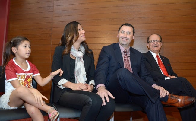 Dec 3, 2013; Los Angeles, CA, USA; Steve Sarkisian (second from right) with Southern California Trojans president C.L. Max Nikias (right) and wife Stephanie Sarkisian (second from left) and daughter Taylor Sarkisian at a press conference to announce his hiring as Southern California Trojans football coach at John McKay Center. Mandatory Credit: Kirby Lee-USA TODAY Sports