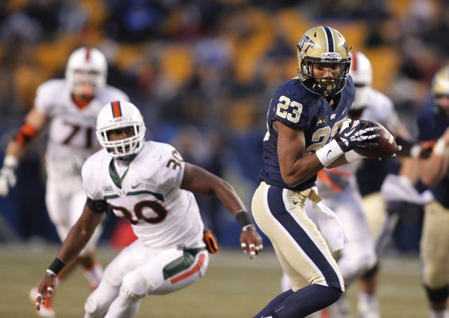Nov 29, 2013; Pittsburgh, PA, USA; Pittsburgh Panthers wide receiver Tyler Boyd (23) runs after a pass reception against the Miami Hurricanes during the second quarter at Heinz Field. Miami won 41-31. Mandatory Credit: Charles LeClaire-USA TODAY Sports