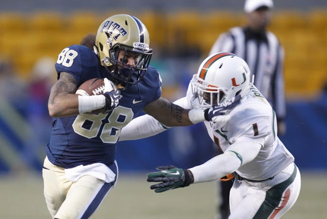 Nov 29, 2013; Pittsburgh, PA, USA; Pittsburgh Panthers wide receiver Kevin Weatherspoon (88) runs after a pass reception against Miami Hurricanes defensive back Artie Burns (1) during the second quarter at Heinz Field. Miami won 41-31. Mandatory Credit: Charles LeClaire-USA TODAY Sports